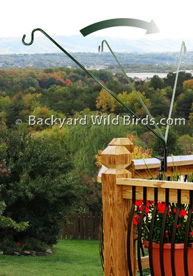 Deck pole bird feeder swing arm